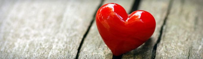 red-hard-romantic-heart-on-grey-background-header