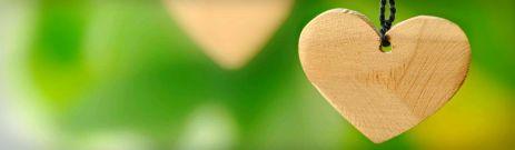 wooden-heart-on-green-background-header